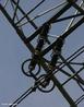 Detalhe de uma coluna de isoladores em uma torre elétrica. <br /><br /> Palavras-chave: Eletromagnetismo, energia elétrica, eletricidade, potência, corrente alternada, usina, cabos, torres, subestações, tensão, transformador.