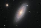 Galáxia espiral NGC 2841 está localizada ao norte da constelação da Ursa Maior. <br /><br />  Palavras-chave: Astronomia, movimento, gravitação universal, galáxia.